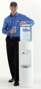 Culligan Man Standing by Bottled Water Cooler